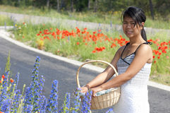Asian girl and flowers Royalty Free Stock Images