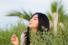 Asian girl in the flowers garden Stock Images