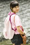 Asian girl at a fountain Royalty Free Stock Image