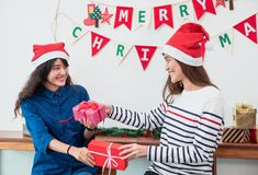 Asian girl friends wear santa hat in merry christmas party and e stock photos