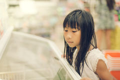 Asian girl in front of sweet candy food store Stock Photography