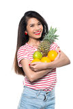 Asian girl with fruits Royalty Free Stock Image