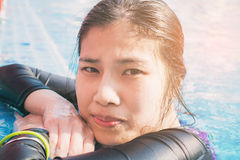Asian girl in full swiming suit on poolside Royalty Free Stock Photography