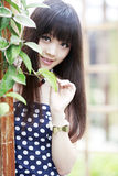 Asian girl in the garden Royalty Free Stock Photos