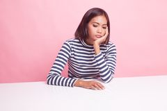 Asian girl is getting bore. Asian girl is getting bore on pink background stock photo