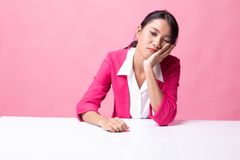 Asian girl is getting bore. On pink background stock image