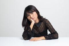 Asian girl is getting bore. On white background royalty free stock photos