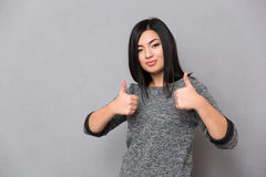 Asian girl giving thumbs-up Stock Image