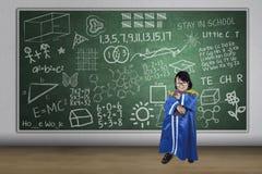 Asian girl graduate holding book in class Stock Photos