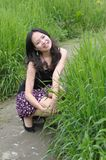 Asian girl in grass Stock Photos