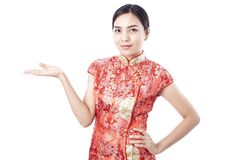 Chinese new year Asian girl. Asian girl greeting in traditional Chinese new year Royalty Free Stock Images
