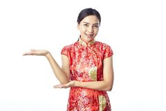 Chinese new year Asian girl. Asian girl greeting in traditional Chinese new year Royalty Free Stock Photos