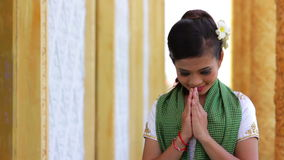 Asian Girl Greets in temple traditional way with both hands Royalty Free Stock Images