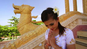 Asian Girl Greets in temple traditional way with both hands Stock Images
