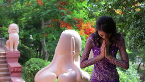 Asian Girl Greets in temple traditional way with both hands stock video