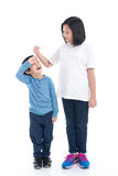 Asian girl growing tall and measuring himself Royalty Free Stock Images