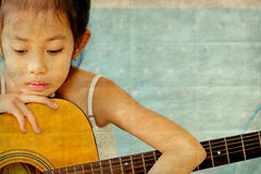 Asian girl with guitar retro style Stock Photos