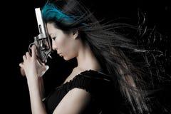 Asian girl with gun Stock Image