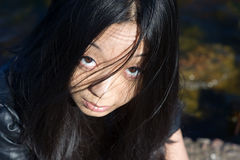 Asian girl with hair on face Stock Photos
