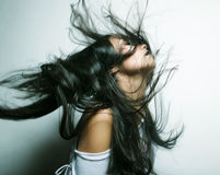 Asian girl with hair lightly fluttering in the wind Stock Photography