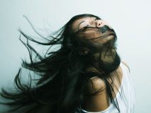 Asian girl with hair lightly fluttering in the wind Royalty Free Stock Images