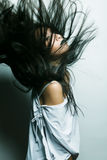 Asian girl with hair lightly fluttering in the wind Royalty Free Stock Photography
