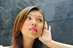 Asian Girl Hand Gesture - Hearing 1 Royalty Free Stock Photos