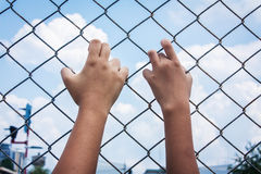 Asian girl hand hold jail Royalty Free Stock Photos