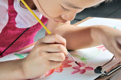 Asian girl hand paint with her watercolor picture Royalty Free Stock Photos
