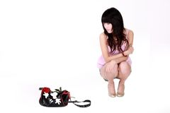 Asian girl with handbag. A beautiful Asian girl and her handbag on white background Stock Photos