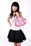 Asian girl with handbag. A beautiful Asian girl with handbag on white background Royalty Free Stock Image