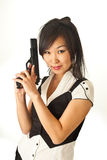 The Asian girl with a handgun Royalty Free Stock Photos