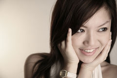 Asian girl with hands on face Royalty Free Stock Image
