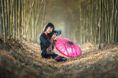 Asian girl happily listening to the radio Stock Images