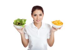 Asian girl happy with crisps and salad Stock Images