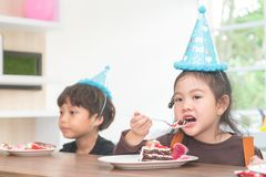 Asian girl happy eating her birthday cake stock photography