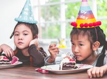 Asian girl happy eating her birthday cake stock photos