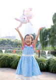 Asian girl happy getting the toy Royalty Free Stock Photo