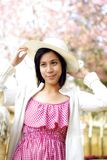 Asian girl with hat in the countryside Royalty Free Stock Photos
