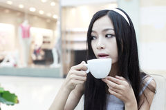 Asian girl having coffee Stock Image