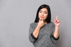 Asian girl having an idea Royalty Free Stock Images