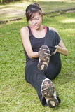 Asian girl having leg cramp. An asian girl having leg craps Stock Photo