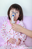 Asian girl having respiratory illness helped by health professio Stock Photos