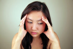 Asian girl with a headache Royalty Free Stock Images