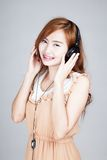 Asian girl with headphone Royalty Free Stock Photos