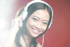 Asian Girl with Headphones Stock Photo