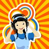Asian girl with headphones. Listening to music Stock Photography