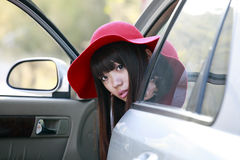 Asian girl with her car royalty free stock image