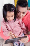 Asian girl and her dad Royalty Free Stock Photos