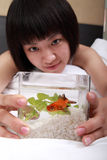 Asian girl with her goldfish Stock Photography